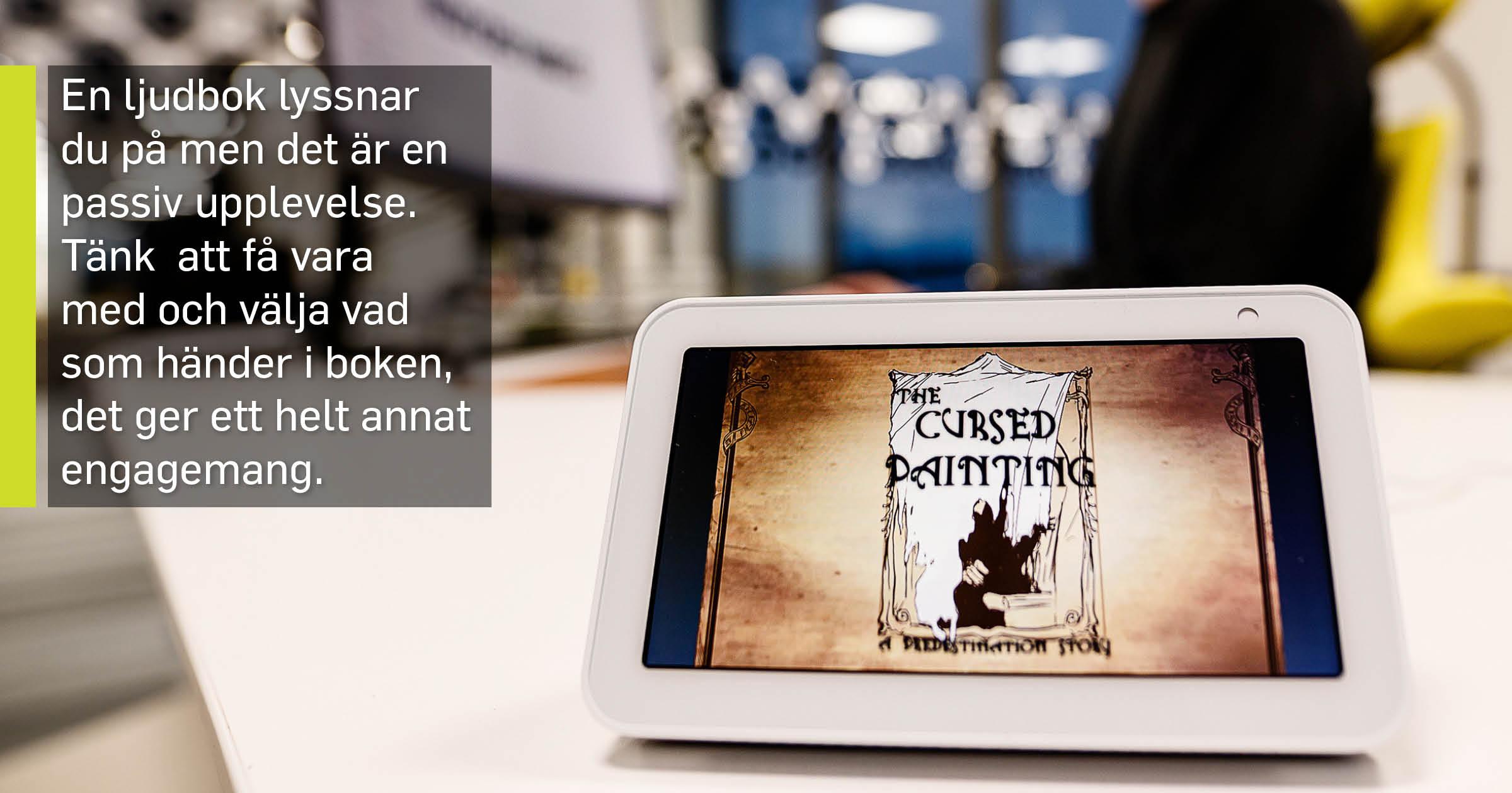 En surfplatta med en bild på en interaktiv bok.